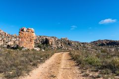 Rock formations on road to start of Maltese Cross trail. Rock formations next to the road to the start of the Maltese Cross hiking trail near Dwarsrivier in the stock photography