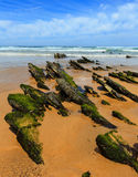 Rock formations on sandy beach Portugal. Royalty Free Stock Photos