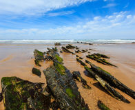 Rock formations on sandy beach Portugal. Royalty Free Stock Image