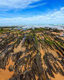 Rock formations on sandy beach Portugal. Stock Photography