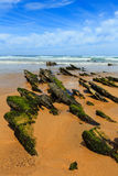 Rock formations on sandy beach Portugal. Royalty Free Stock Images