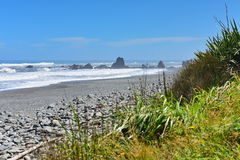 Rock formations and scenic landscape at Motukiekie Beach in New Zealand Stock Image