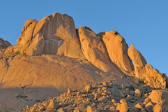 Rock formations at Spitzkoppe in Namibia at sunset. Rock formations resembling a falcon, shark and baboon at Spitzkoppe in Namibia at sunset. The sandstone royalty free stock photos