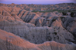 Rock formations at sunset in Badlands National Park. South Dakota.  The Rock formations are more like a hardened soil made from volcanic ash Stock Photos