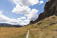 Rock Formations. Trail, cloudy blue sky, and rock formations at Tower Rock State Park in Montana, USA royalty free stock images