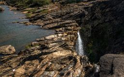 Rock formations and waterfalls. Waterfall in the summer showing rock formations made up over the years on top of the mountain Stock Photo