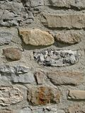 Rock foundation wall. Stone foundation or wall on older building, vertical Stock Photo