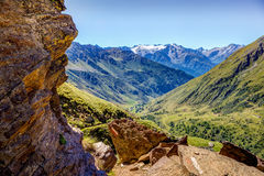 Rock framed view on mountains and valley in Ponte di Legno, Case Royalty Free Stock Photo