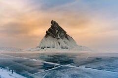 Rock on freeze lake with sunrise sky background. Baikal winter season natural landscape background Stock Photography