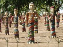 The Rock Garden Chandigarh India. Sculpted women in The Rock Garden, Chandigarh India. An art space spread over 40 acres made of recycled industrial and home royalty free stock photography