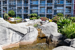Rock garden in front of condo. A rock garden in front of condo Royalty Free Stock Images