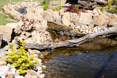 Rock garden with a pond in the park staging Stock Image