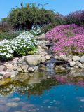 Rock garden with pool and waterfalls stock images