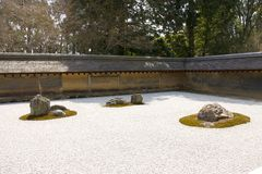 Rock garden in Ryoan-ji temple, Kyoto, Japan. Stock Photo
