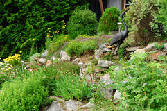 Rock garden with solar lamp stock photography