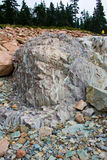Rock geology. Large crumbling rock with mineral lines running through it stock image