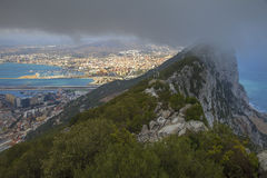 The Rock of Gibraltar. In the fog, overlooking the Spanish port of Algeciras Stock Photos