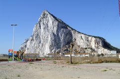 View of the Rock of Gibraltar. The Rock of Gibraltar is the state of Gibraltar from the Spanish border. Gibraltar is a British Overseas Territory located at the Royalty Free Stock Photography