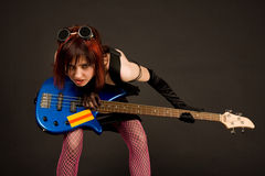 Rock girl with bass guitar royalty free stock photography