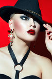Rock girl in a black hat with red lips. Stock Photo