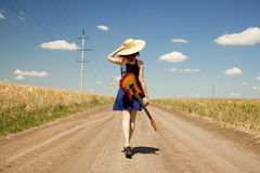 Rock girl with guitar at countryside Royalty Free Stock Photography