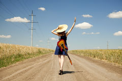 Rock girl with guitar at countryside Stock Image