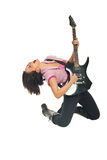 Rock girl with guitar singing. And sitting on her knees isolated on white background Royalty Free Stock Image