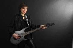 Rock Girl In Leather Outfit With Electric Guitar Stock Images