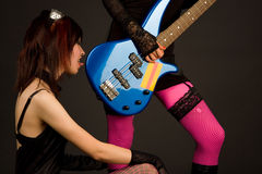 Rock girl licking bass guitar Royalty Free Stock Images