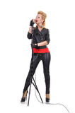 Rock girl with microphone Stock Images