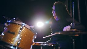 Rock girl percussion drummer performing with drums, slow motion stock video footage