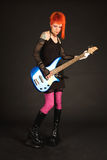Rock girl playing bass guitar Stock Photography