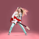 Rock girl. Portrait of young girl with a guitar on the stage Stock Photography