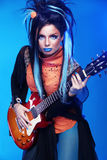 Rock girl posing with electric guitar playing hard-rock  Stock Photography