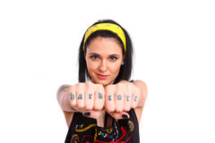 Rock girl showing her tattoos on her fist Stock Photo