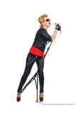 Rock girl singer. With microphone on white background stock images