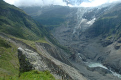 Rock and glacier in valley nearby Grindelwald in Switzerland stock image