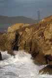 Rock and golden gate Stock Photography