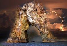Rock Golden Gate of Karadag during a thunderstorm stock photos