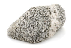 Rock. Granite rock isolated on white Royalty Free Stock Photography