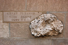 A rock from the Great Pyramid, embedded in a wall in Chicago. A Rock from Great Pyramid is embedded in the exterior wall of Chicago`s Tribune Building, showing Stock Photography