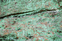 Rock with green lichen Royalty Free Stock Images