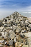 Rock groin jutting out into the Pacific Ocean - California Stock Photography