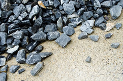 Rock on the ground. Grey rock on the ground Stock Photos