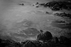 Rock group. Beautiful rock group in the sea with B&W tone royalty free stock photography