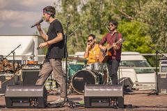 Rock group performs live. In an outdoor concert royalty free stock photography