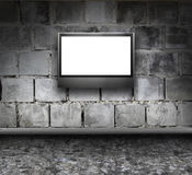 Rock grunge interior with LCD tv Stock Photos