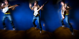 Rock Guitar. A young man playing rock music on a guitar Stock Photography