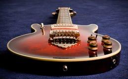 Rock guitar. On blue carpet Royalty Free Stock Photo
