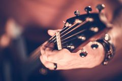 Rock Guitar Player. Concept Photo. Hands on the Electric Guitar. Shallow Depth of Field stock photos